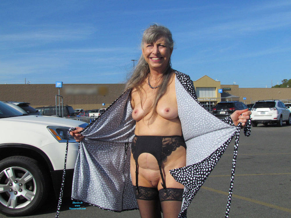 a sweet granny is flashing her awesome tits near a public commercial center #1