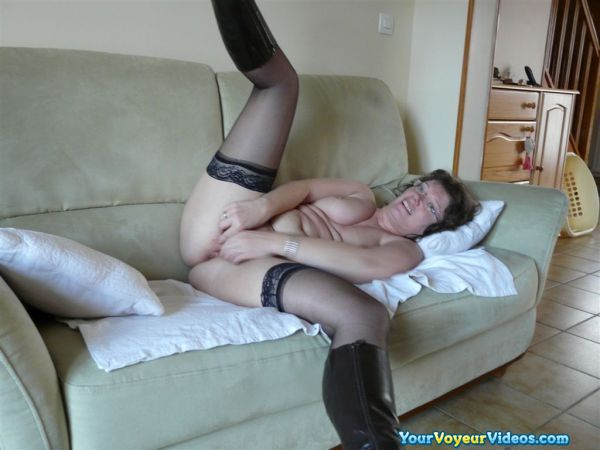 a charming slutty housewife spreading her legs on her comfy sofa #2