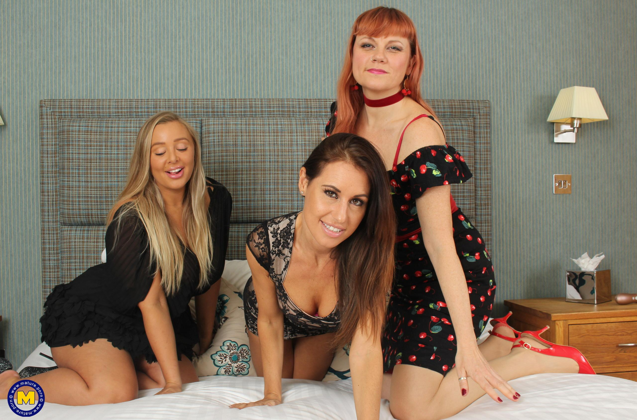 two mature, slightly older swinger women are struggling between the legs of a young woman picture 2