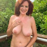 pretty nudist mom exposing her thick tits and large slit picture 10