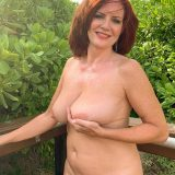 pretty nudist mom exposing her thick tits and large slit picture 9
