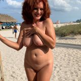 pretty nudist mom exposing her thick tits and large slit picture 6