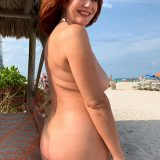 pretty nudist mom exposing her thick tits and large slit picture 5