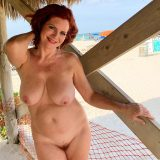 pretty nudist mom exposing her thick tits and large slit picture 13