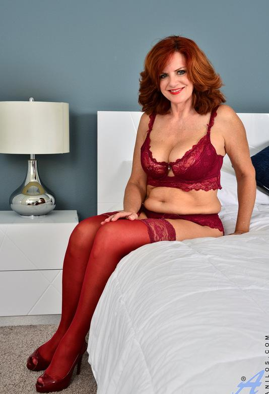 Red-haired mature shows her generous basin and big vulva picture 2