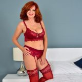 Red-haired mature shows her generous basin and big vulva picture 3