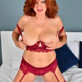 Red-haired mature shows her generous basin and big vulva picture 6