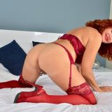 Red-haired mature shows her generous basin and big vulva picture 13