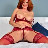 Red-haired mature shows her generous basin and big vulva picture 7