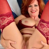 Red-haired mature shows her generous basin and big vulva picture 11