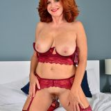 Red-haired mature shows her generous basin and big vulva picture 15