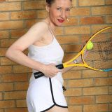 ole sportive women rubs her ole little cunt to climax after a tennis lesson picture 3