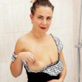 sweet mature alisia rinsing her hairy triangle inside the shower picture 5