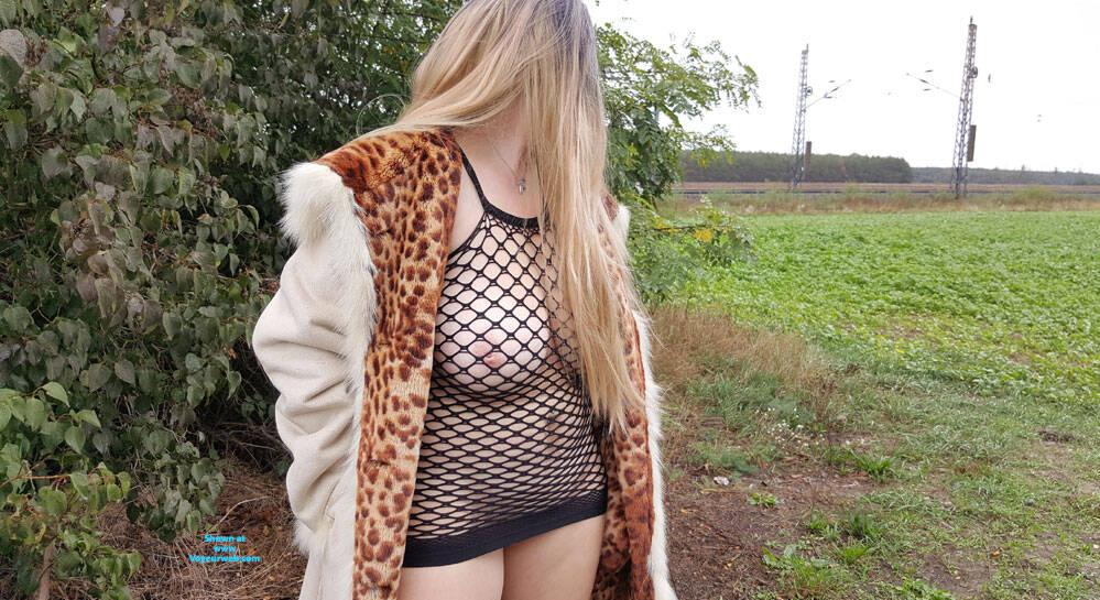 unemployed mature lady from east germany flashing near the railroad tracks picture 2